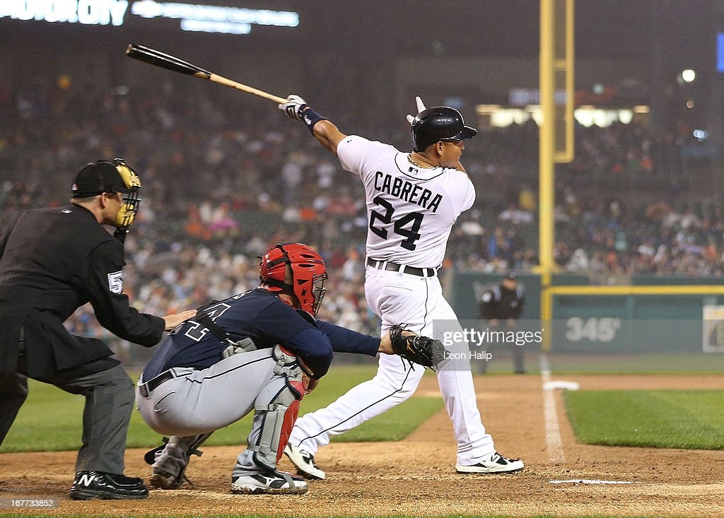 Miguel Cabrera #24 of the Detroit Tigers hits a three-run home run in the seventh inning scoring Austin Jackson #14 and Torii Hunter #48 during the game against the Atlanta Braves at Comerica Park on April 28, 2013 in Detroit, Michigan.
