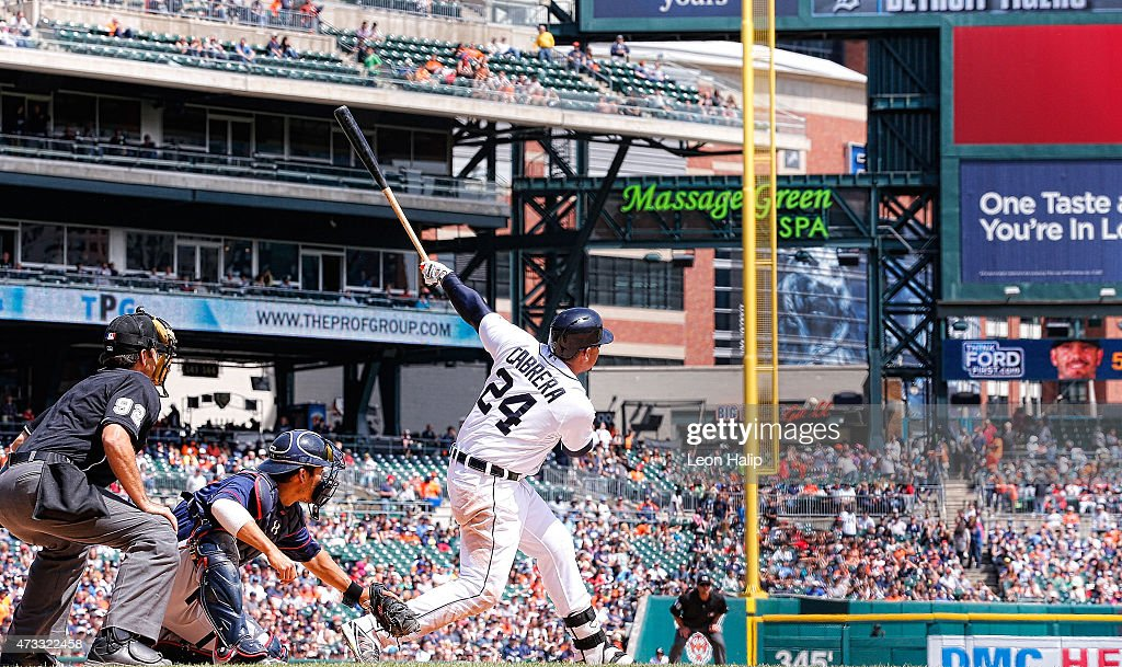 Miguel Cabrera #24 of the Detroit Tigers hits a two run home run to left field scoring Ian Kinsler (not in photo) during the sixth inning of the game against the Minnesota Twins on May 14, 2015 at Comerica Park in Detroit, Michigan.