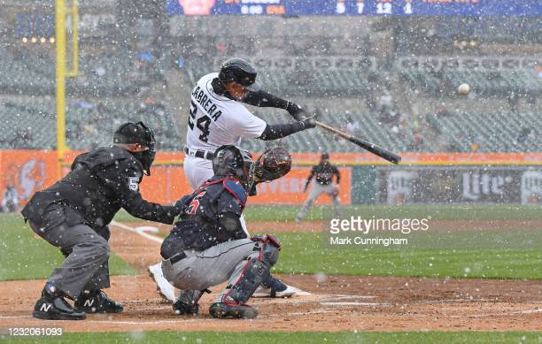 Miguel Cabrera of the Detroit Tigers hits a two-run home run in the first inning of the Opening Day game against the Cleveland Indians at Comerica...