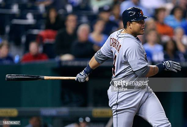 Miguel Cabrera of the Detroit Tigers hits a tworun single against the Kansas City Royals in the third inning at Kauffman Stadium on October 2 2012 in...