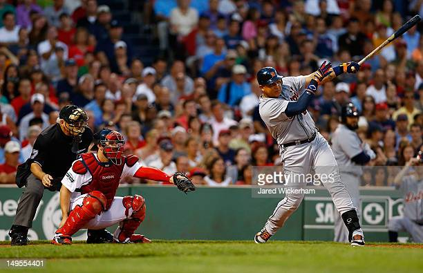 Miguel Cabrera of the Detroit Tigers hits an RBI single in the third inning against the Boston Red Sox during the game on July 30 2012 at Fenway Park...
