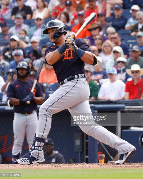 Miguel Cabrera of the Detroit Tigers hits the ball against the Houston Astros during a spring training game at the FITTEAM Ballpark of the Palm...