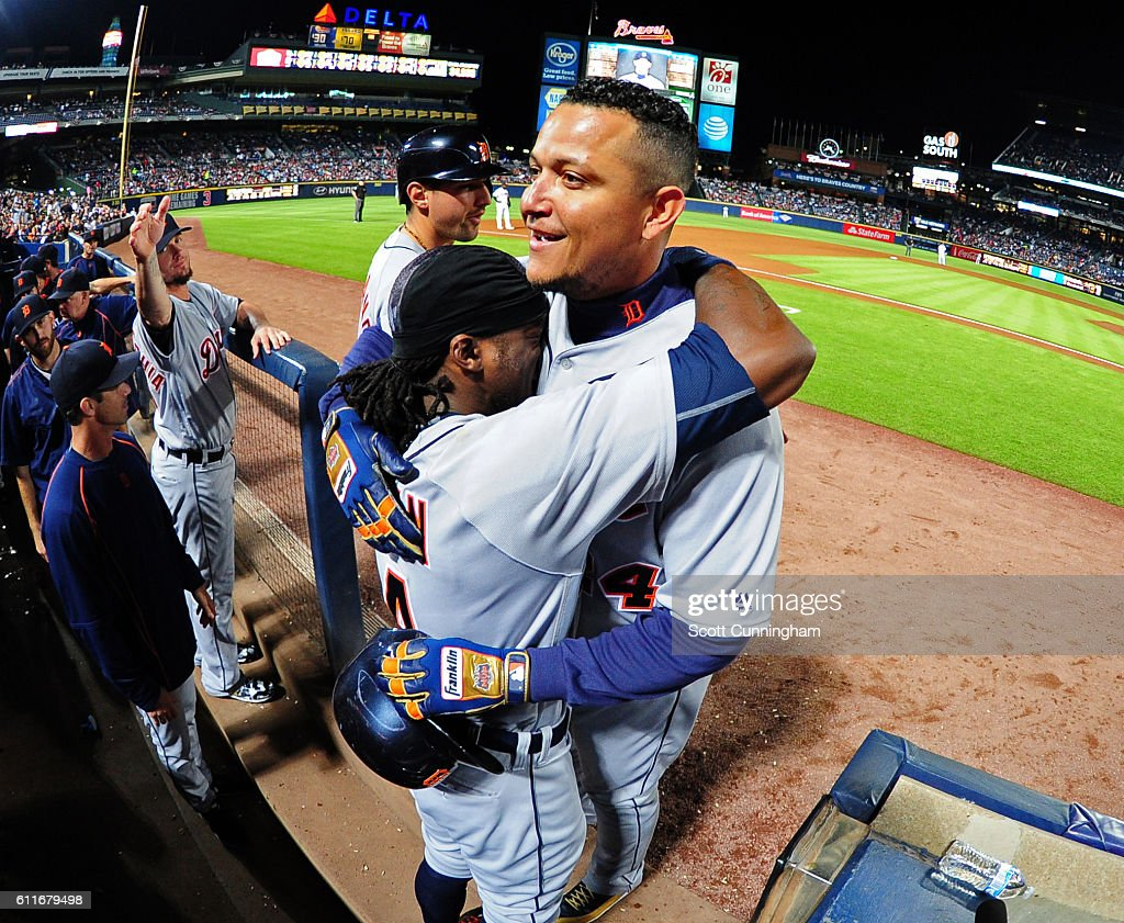 Miguel Cabrera #24 of the Detroit Tigers is congratulated by Cameron Maybin #4 after hitting a third inning solo home run against the Atlanta Braves at Turner Field on September 30, 2016 in Atlanta, Georgia.
