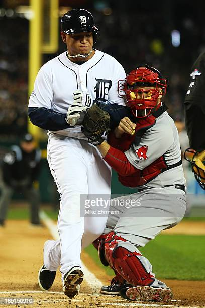 Miguel Cabrera of the Detroit Tigers is out at home by David Ross of the Boston Red Sox on a single by Jhonny Peralta of the Detroit Tigers in the...