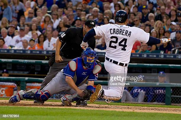 Miguel Cabrera of the Detroit Tigers is tagged out at home plate in the fourth inning by catcher Bobby Wilson of the Texas Rangers during a MLB game...