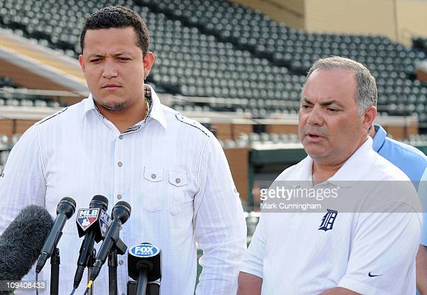 Miguel Cabrera of the Detroit Tigers looks on as Tigers Vice President and Assistant General Manager Al Avila speaks to the media during a press...