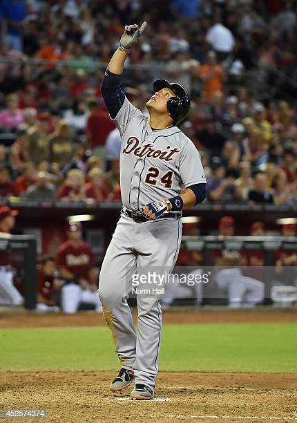 Miguel Cabrera of the Detroit Tigers points to the sky after hitting a three-run home run during the eighth inning against the Arizona Diamondbacks...