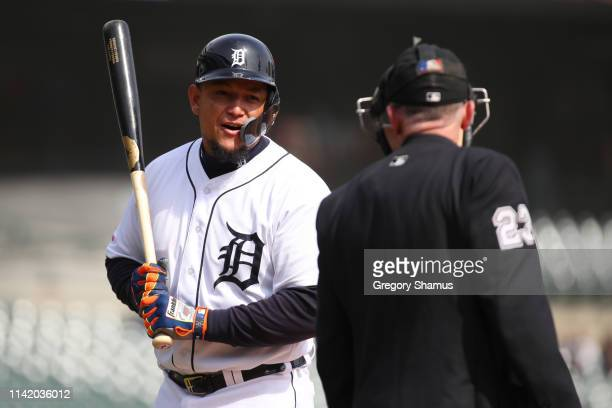 Miguel Cabrera of the Detroit Tigers reacts to a called third strike in the ninth inning while playing the Cleveland Indians at Comerica Park on...