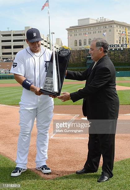 Miguel Cabrera of the Detroit Tigers receives his 2010 Louisville Slugger Silver Slugger Award from Tigers vice president and assistant general...