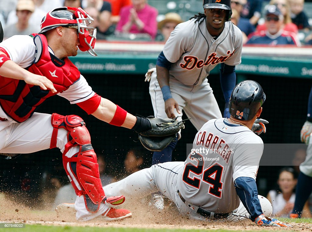 Miguel Cabrera #24 of the Detroit Tigers scores ahead of the tag by Chris Gimenez #38 of the Cleveland Indians in the third inning at Progressive Field on September 18, 2016 in Cleveland, Ohio.