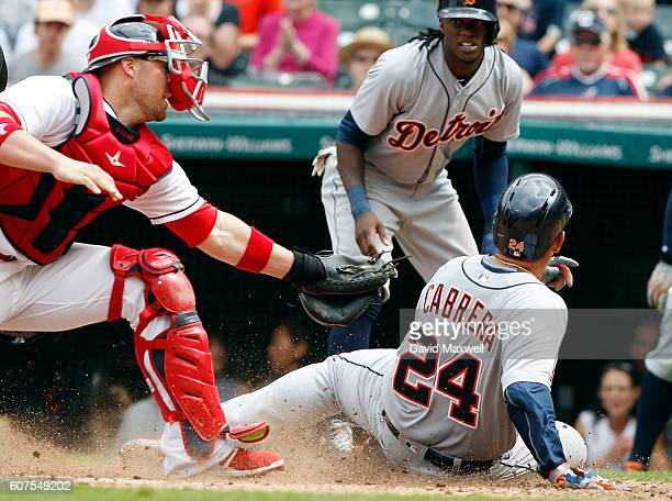Miguel Cabrera of the Detroit Tigers scores ahead of the tag by Chris Gimenez of the Cleveland Indians in the third inning at Progressive Field on...