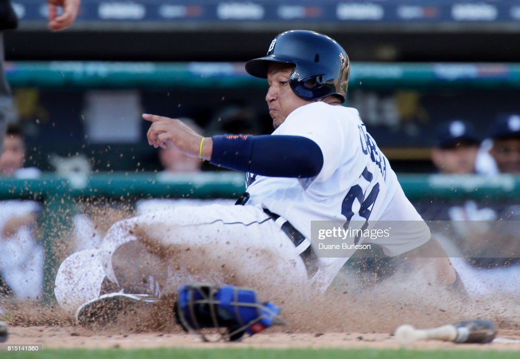 Miguel Cabrera #24 of the Detroit Tigers scores from third base on a sacrifice fly ball hit by Mikie Mahtook of the Detroit Tigers during a game against the Toronto Blue Jays at Comerica Park on July 15, 2017 in Detroit, Michigan.