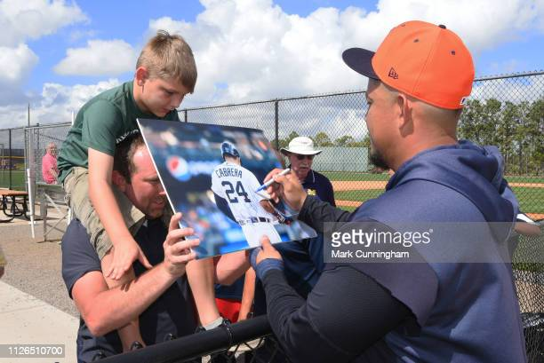 Miguel Cabrera of the Detroit Tigers signs an autograph for a fan during Spring Training workouts at the TigerTown Facility on February 20 2019 in...