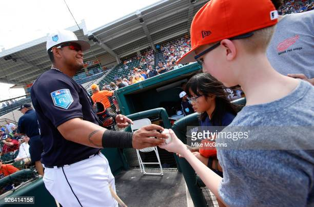 Miguel Cabrera of the Detroit Tigers signs some autographs before the Spring Training game against the Miami Marlins at Joker Marchant Stadium on...