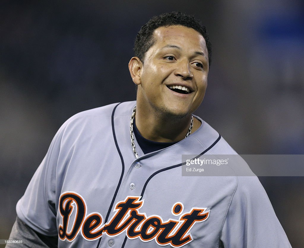 Miguel Cabrera #24 of the Detroit Tigers smiles as he stands on first after hitting a two-run single against the Kansas City Royals in the third inning at Kauffman Stadium on October 2, 2012 in Kansas City, Missouri.