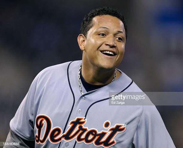 Miguel Cabrera of the Detroit Tigers smiles as he stands on first after hitting a tworun single against the Kansas City Royals in the third inning at...