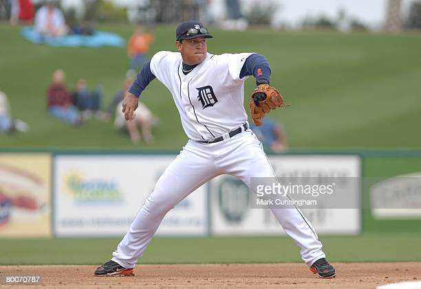 Miguel Cabrera of the Detroit Tigers throws during the game against the New York Mets at Joker Marchant Stadium in Lakeland, Florida on February 27,...