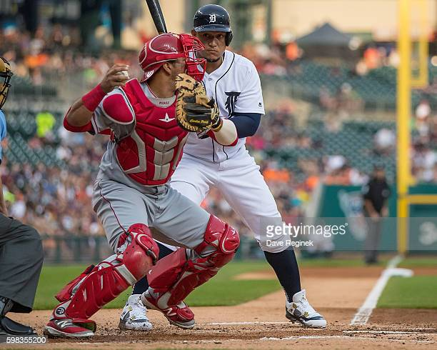Miguel Cabrera of the Detroit Tigers watches as Carlos Perez of the Los Angeles Angels attempts a throw to second base on a steal in the first inning...