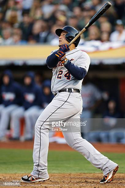 Miguel Cabrera of the Detroit Tigers watches his two-run home run in the fourth inning against the Oakland Athletics during Game Five of the American...