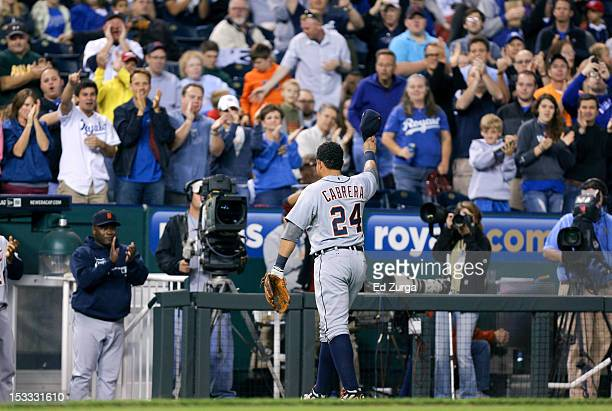 Miguel Cabrera of the Detroit Tigers waves his cap to the crowd as he leaves a game against the Kansas City Royals in the fourth inning at Kauffman...