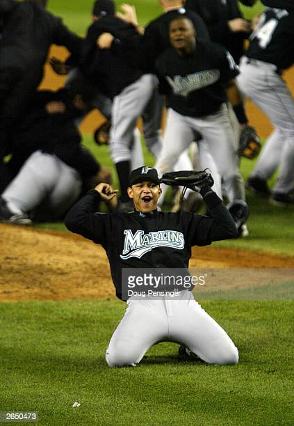 Miguel Cabrera of the Florida Marlins celebrates the Marlins' 2-0 win over the New York Yankees in game six of the Major League Baseball World Series...