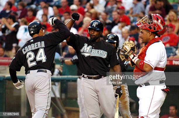 Miguel Cabrera of the Florida Marlins is congratulated by Carlos Delgado after hitting a tworun home run in the third inning as Los Angeles Angels of...