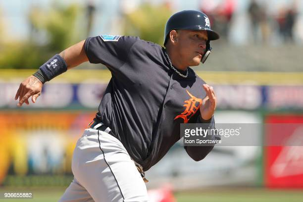 Miguel Cabrera of the Tigers hustles around third base towards home to score a run during the spring training game between the Detroit Tigers and the...