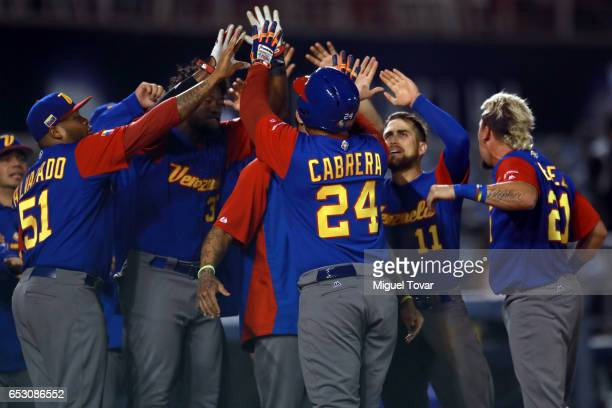 Miguel Cabrera of Venezuela celebrates after hitting a home run in the top of the ninth inning during the World Baseball Classic Pool D Game 7...