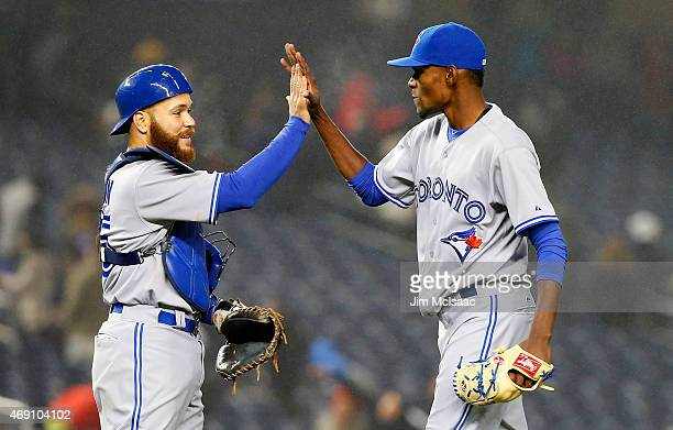 Miguel Castro and catcher Russell Martin celebrate after defeaating the New York Yankees at Yankee Stadium on April 9 2015 in the Bronx borough of...