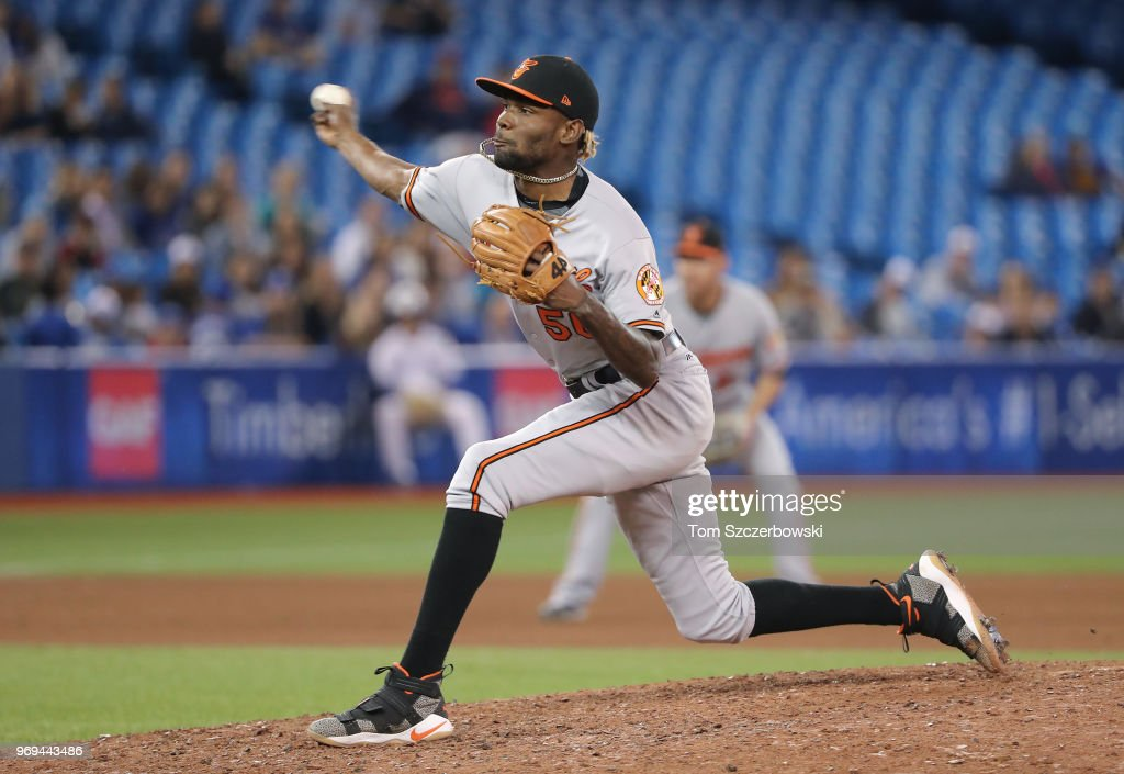 Miguel Castro #50 of the Baltimore Orioles delivers a pitch in the tenth inning during MLB game action against the Toronto Blue Jays at Rogers Centre on June 7, 2018 in Toronto, Canada.