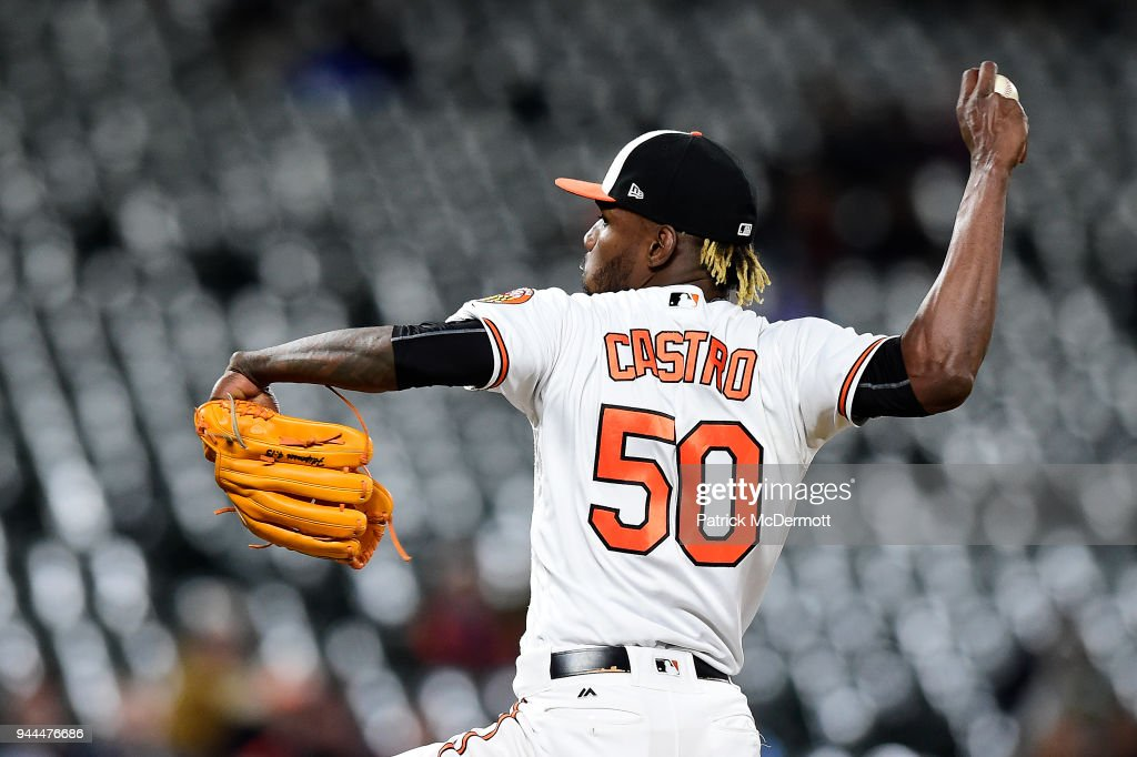 Miguel Castro #50 of the Baltimore Orioles throws a pitch against the Toronto Blue Jays in the eighth inning at Oriole Park at Camden Yards on April 10, 2018 in Baltimore, Maryland.