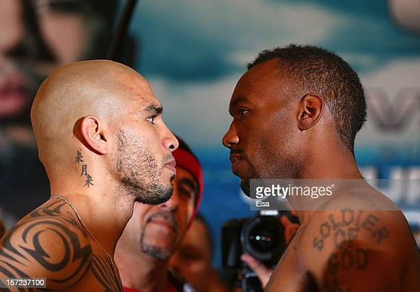 Miguel Cotto and Austin Trout stare each other down after the weigh in before the fight for Trout's Super Welterweight Title at Affinia Hotel on...