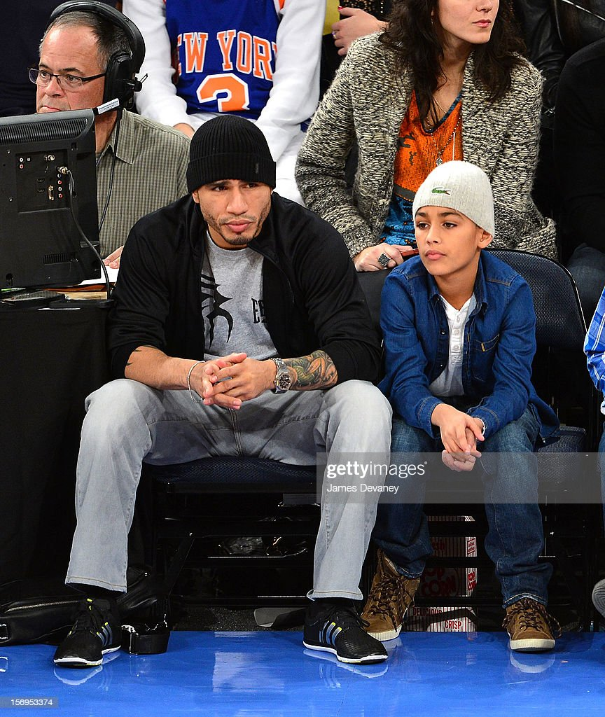 Miguel Cotto and son Miguel Cotto III attend the Detroit Pistons vs New York Knicks game at Madison Square Garden on November 25, 2012 in New York City.