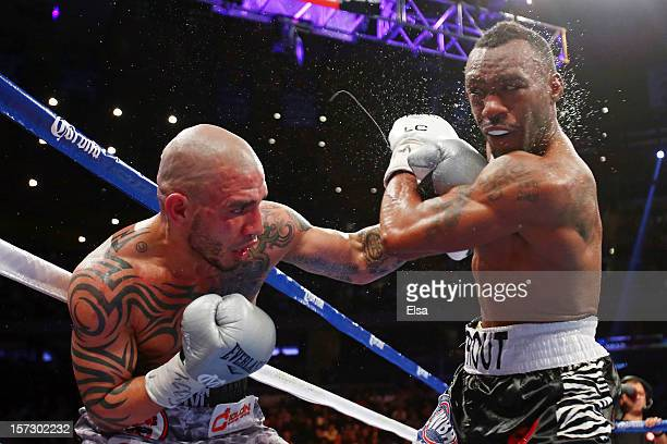 Miguel Cotto connects on a punch while fighting against Austin Trout in their WBA Super Welterweight Championship title fight at Madison Square...