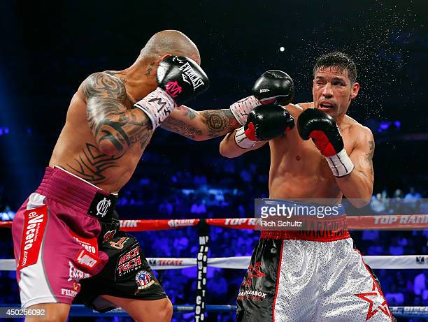 Miguel Cotto of Puerto Rico battles Sergio Martinez of Argentina during the third round during the WBC Middleweight Championship fight on June 7 2014...