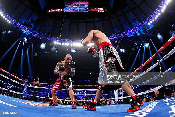 Miguel Cotto of Puerto Rico fights Sergio Martinez of Argentina in the sixth round of their WBC Middleweight Championship fight on June 7 2014 at...