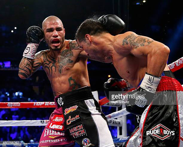 Miguel Cotto of Puerto Rico glances a left punch off the head of Sergio Martinez of Argentina during the third round of the WBC Middleweight...