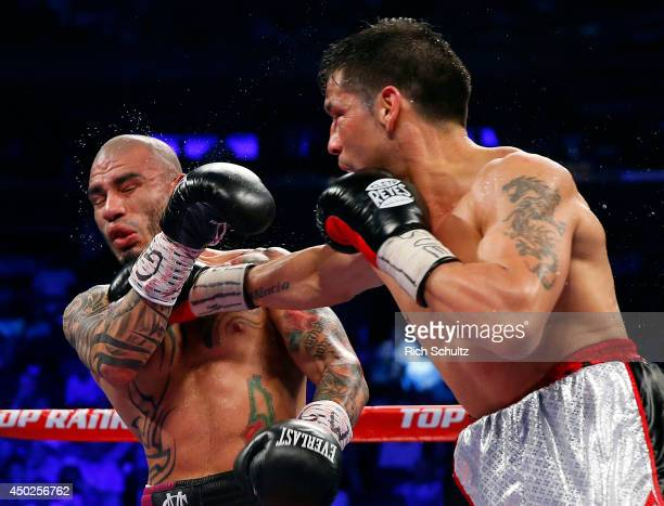 Miguel Cotto of Puerto Rico is hit in the jaw by a right hand punch by Sergio Martinez of Argentina during the eighth round as they battle for the...