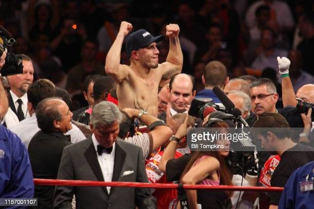 June 13: Miguel Cotto raises his hands in victory after his bout with Joshua Clottey that he won by Split Decision in their WBO Welterweight...