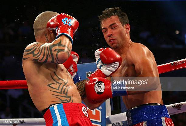 Miguel Cotto throws a punch against Delvin Rodriguez during a Super Welterweight bout at Amway Center on October 5 2013 in Orlando Florida