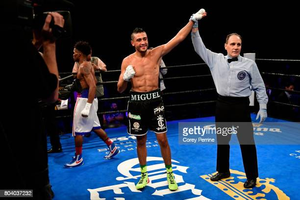 Miguel Cruz is presented the winner by referee Gary Rosato after defeating Alex Martin during a main event welterweight bout at the Sands Bethlehem...
