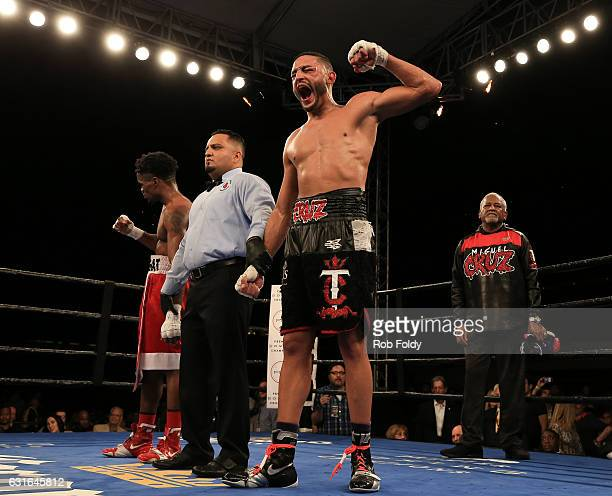 Miguel Cruz reacts after being declared the winner of a bout against Alex Martin at Hialeah Park on January 13 2017 in Miami Florida