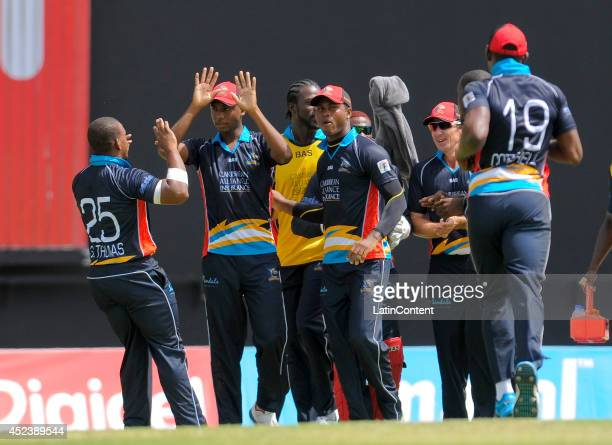 Miguel Cummins of Antigua Hawksbills celebrates with teammates catching a ball during a match between Antigua Hawksbills and Barbados Tridents as...