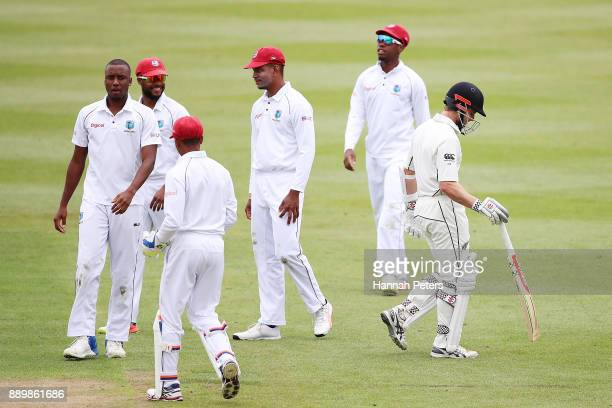 Miguel Cummins of the West Indies celebrates after bowling Kane Williamson of New Zealand out during day three of the Second Test Match between New...