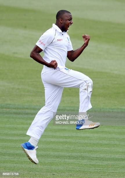 Miguel Cummins of the West Indies celebrates the wicket of Henry Nicholls of New Zealand during day three of the second Test cricket match between...