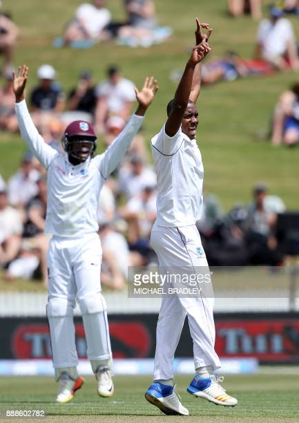Miguel Cummins of the West Indies celebrates the wicket of Kane Williamson of New Zealand during day one of the second Test cricket match between New...