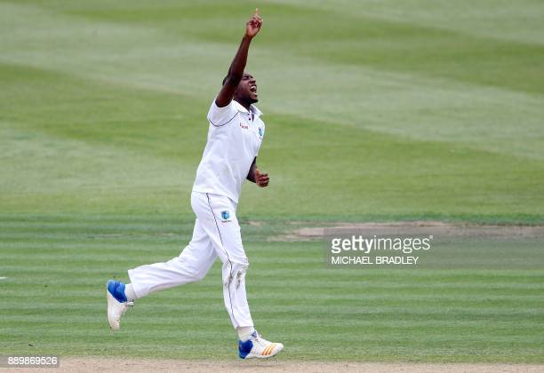 Miguel Cummins of the West Indies celebrates the wicket of Kane Williamson of New Zealand during day three of the second Test cricket match between...