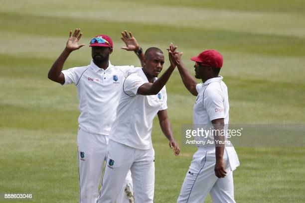 Miguel Cummins of the West Indies celebrates with teammates for the wicket of Kane Williamson of New Zealand during day one of the second Test match...