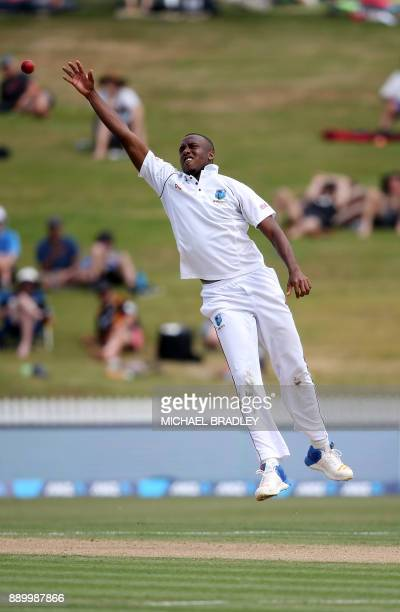 Miguel Cummins of the West Indies looks to field off his own bowling during day three of the second Test cricket match between New Zealand and the...