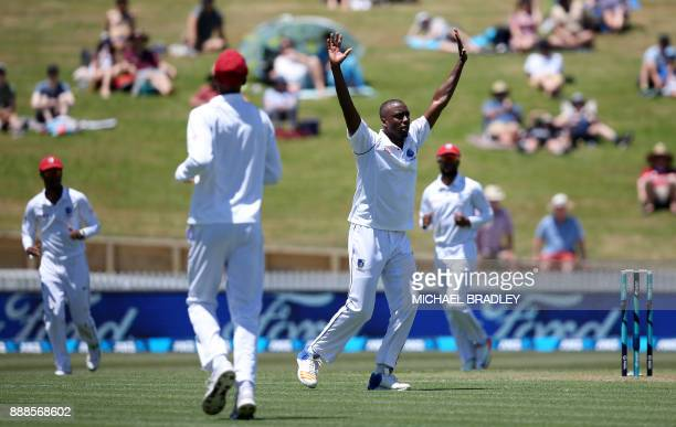 Miguel Cummins of the West Indies takes the wicket of Tom Latham of New Zealand bats during day one of the second Test cricket match between New...